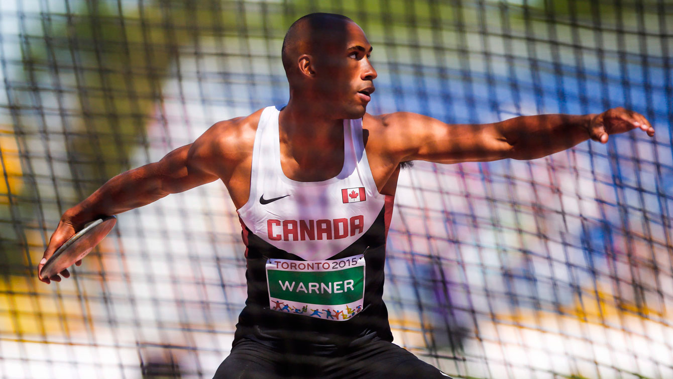 Damian Warner in the process of launching the discus at the Pan Am Games on July 23, 2015 as part of the decathlon.