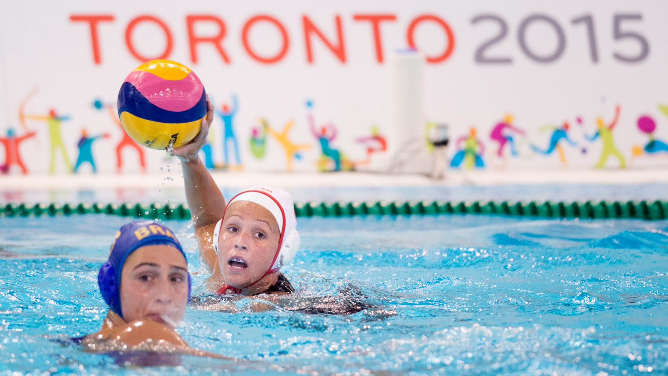 Shae Fournier of Canada (right) looks to pass during a Pan Am Games match against Brazil on July 7, 2015.