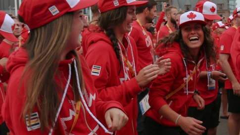 Members of the women's field hockey team at the athletes' village opening for Toronto 2015 Pan American Games in their Hudson's Bay hoodies and ball caps from the official kit.