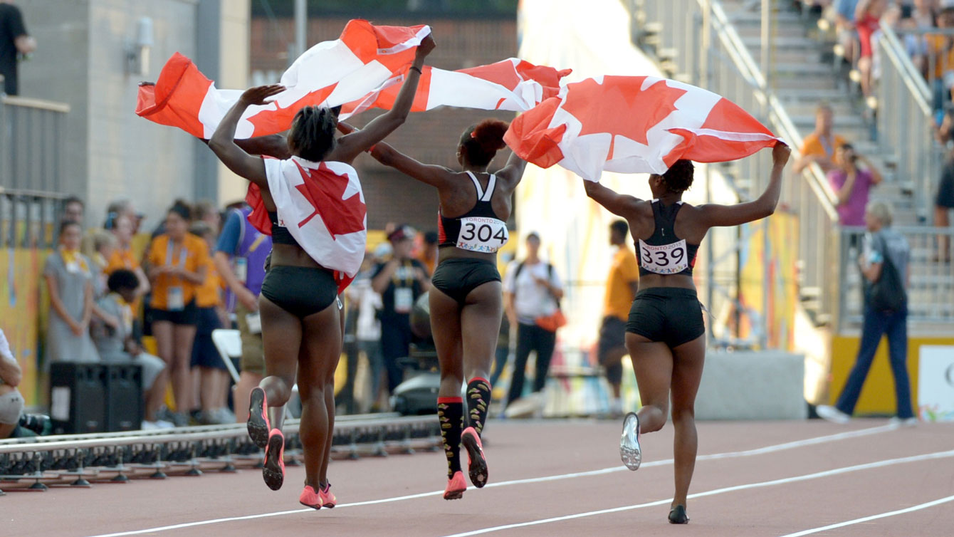 Canadian women's 4x100m Pan Am Games relay team takes a celebratory lap after winning bronze on July 25, 2015.