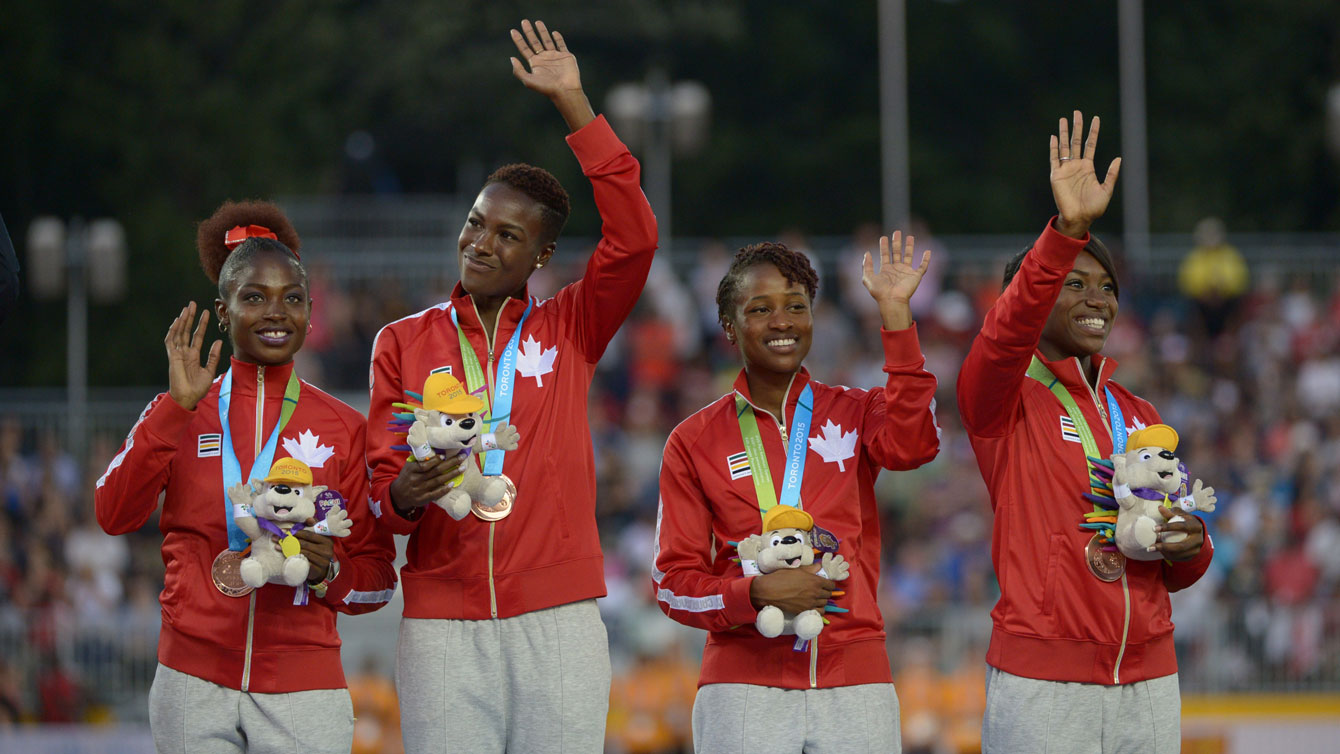 Canadian women's relay team receive their 4x100m bronze medal at the Pan Am Games in Toronto on July 25, 2015.