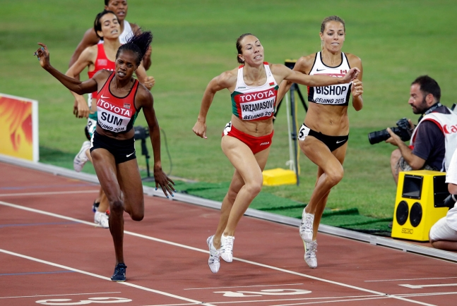 Bulgaria's Marina Arzamasova (centre) leans in ahead of Canada's Melissa Bishop (right) and Kenya's Eunice Sum at the IAAF World Championships in Athletics women's 800 metres final on August 29, 2015.