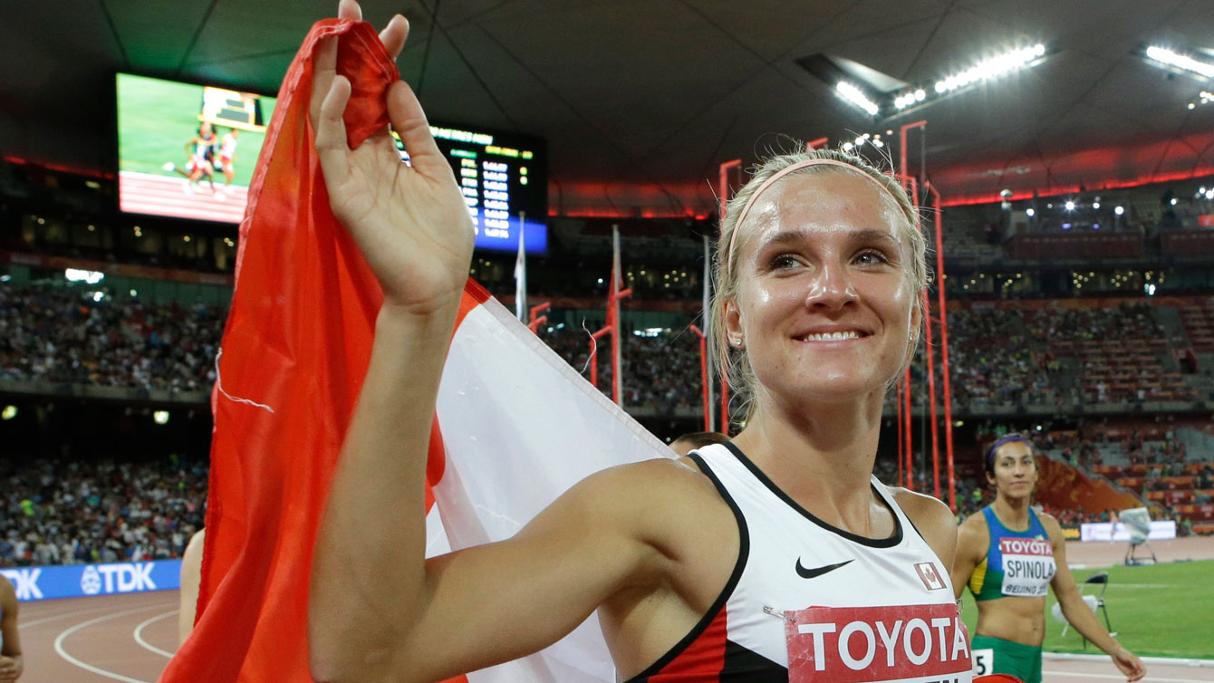 Brianne Theisen-Eaton with the maple leaf following her silver medal performance in heptathlon at the IAAF World Championships in Athletics - Beijing, China on August 23, 2015.