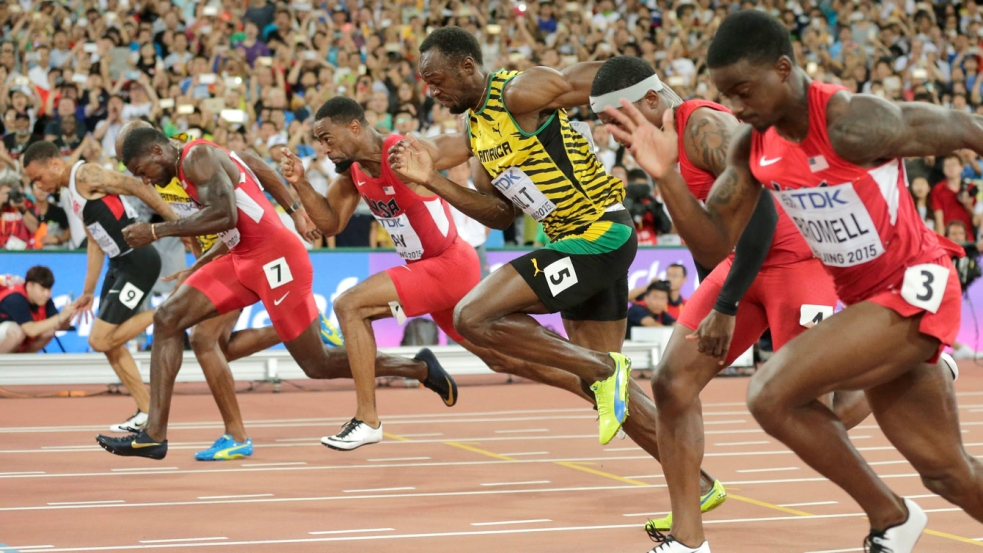 Andre De Grasse (outside, far left) leans in for bronze as Usain Bolt (5) and Justin Gatlin (7) battle for gold and silver in the closing moments of the 100m final at the IAAF World Championships in Athletics in Beijing, China on August 23, 2015.