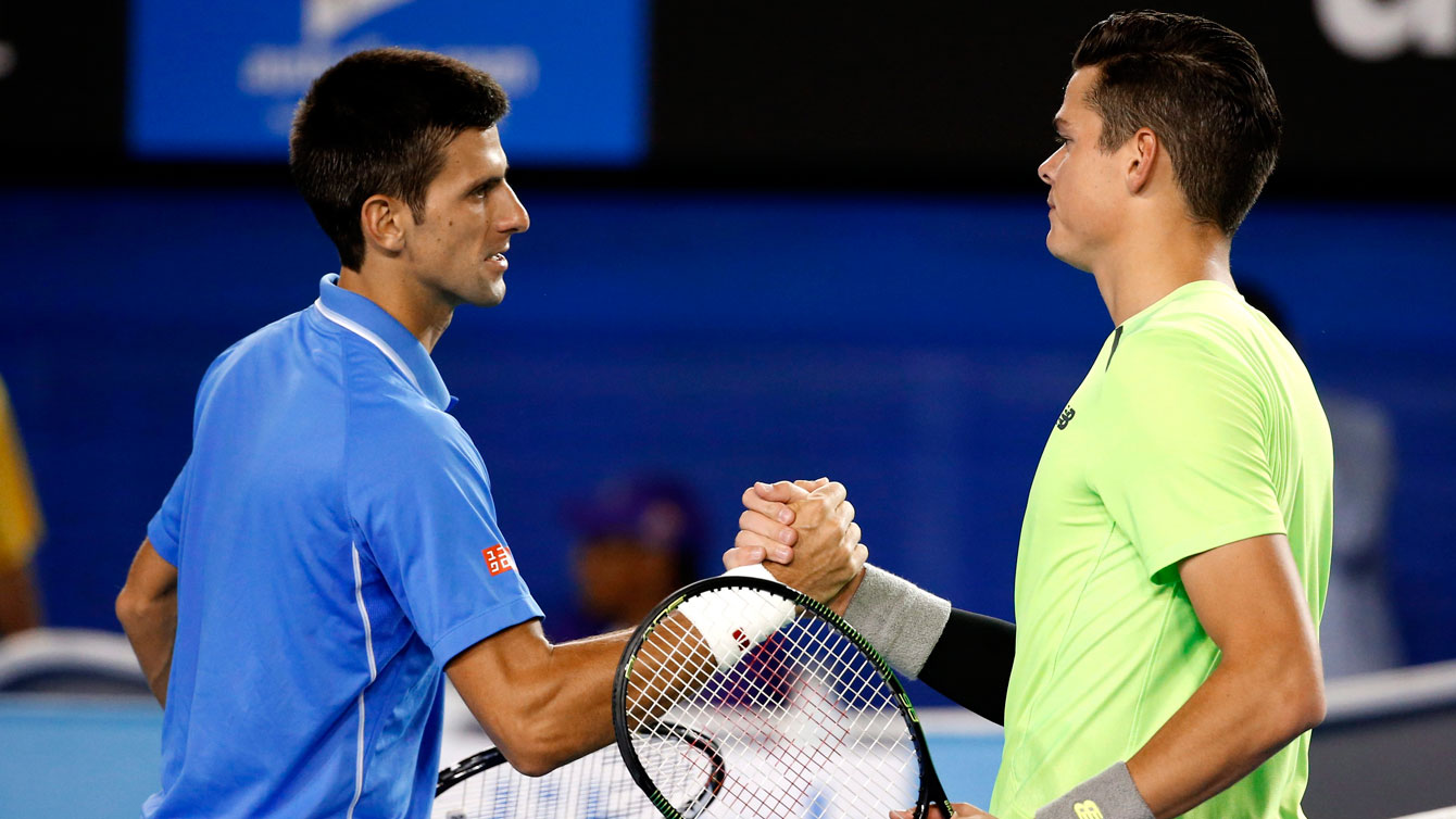 World's top tennis player Novak Djokovic is congratulated by Canada's Milos Raonic (right) after the Serbian won their quarterfinal match at the Australian Open on January 28, 2015.