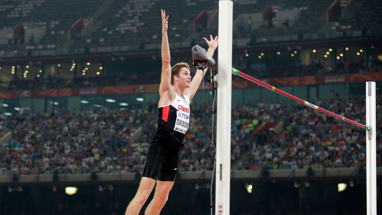 Derek Drouin celebrates a clearance in the high jump at the IAAF World Championships in Athletics on August 30, 2015.