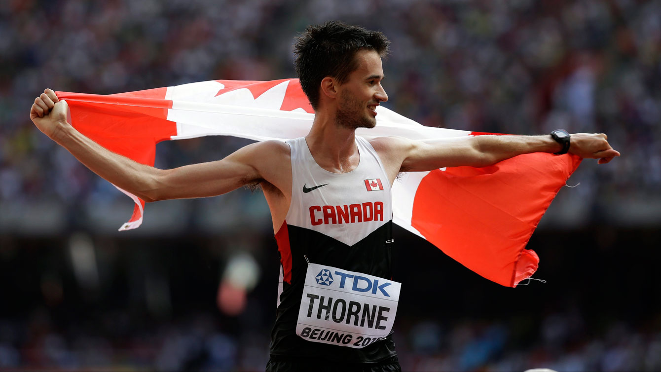 Ben Thorne holds up the maple leaf after winning IAAF World Championship in Athletics bronze medal in 20km race walk on August 23, 2015 in Beijing, China.