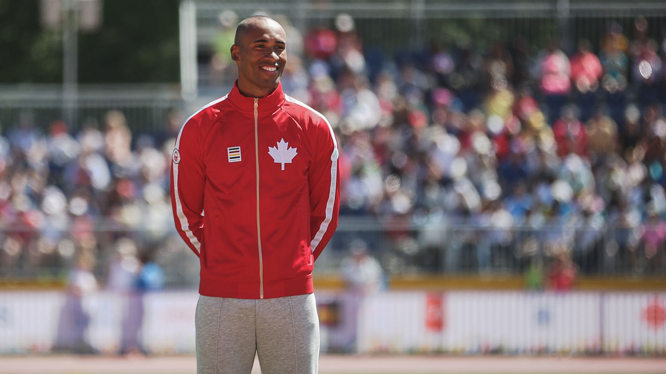 Damian Warner on the podium prior to receiving his decathlon gold medal at Toronto 2015 Pan American Games.