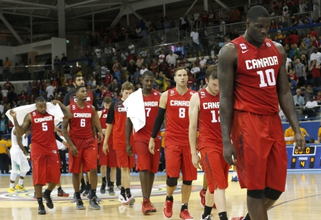 Anthony Bennett, right, leads the way as Canada leaves the court