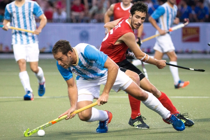 Argentina's Juan Gilardi, left, turns away from Canada's Matthew Guest