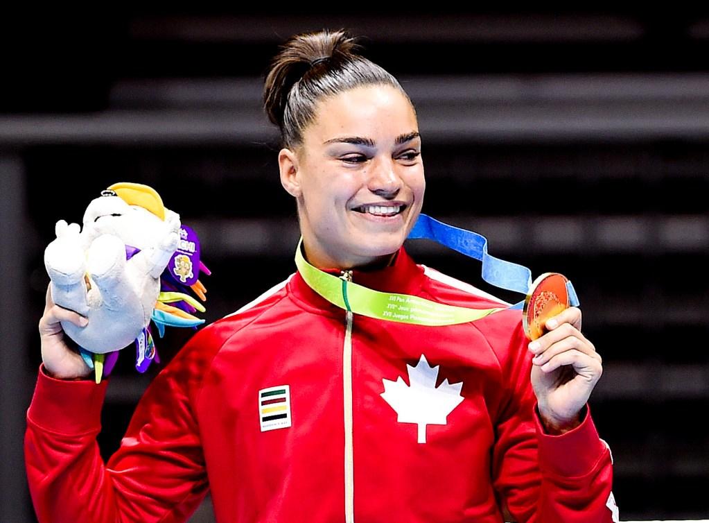 Caroline Veyre shows off her gold medal