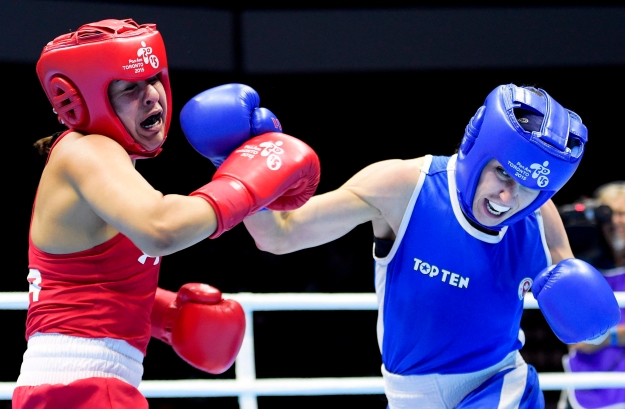 Mandy Bujold, right, of Canada, competes against Marlen Esparza, of the United States