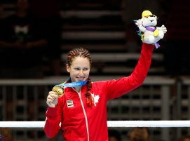 Canada's Mandy Bujold shows off her gold medal