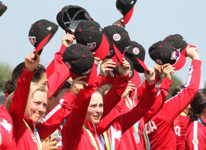 Canada's women's baseball team acknowledges fans after receiving their silver medals