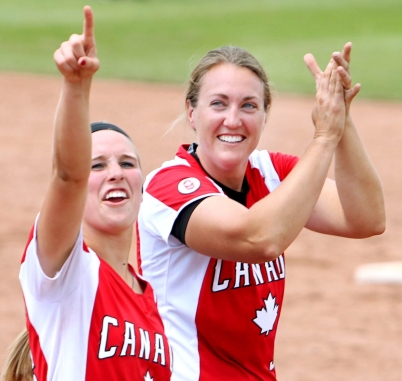Team Canada players Larissa Franklin and Kaleigh Rafter acknowledge the fan