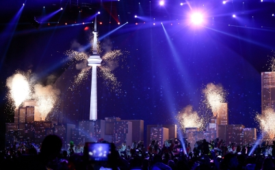 Fireworks go of from a model of the Toronto skyline on the stage of the closing ceremony of the Pan Am Games