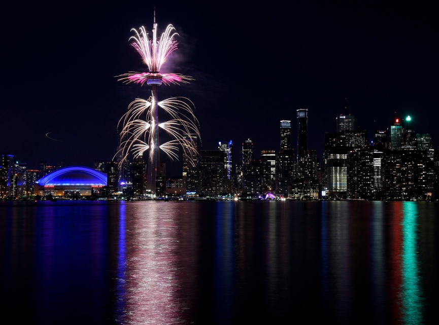 Fireworks light up the downtown Toronto city skyline during the closing ceremony for the Pan American Games
