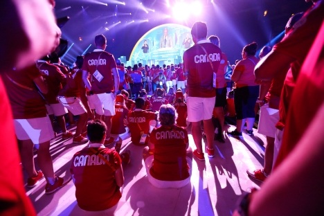 The Canadian delegation watches a performance during the closing ceremony of the Pan Am Games
