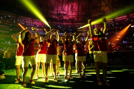 Canadian athletes dance during a performance at the closing ceremony of the Pan Am Games