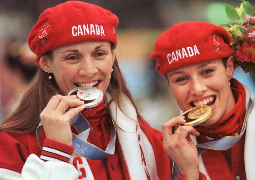 Catriona Le May Doan (right) and Susan Auch celebrate their gold and silver medals.