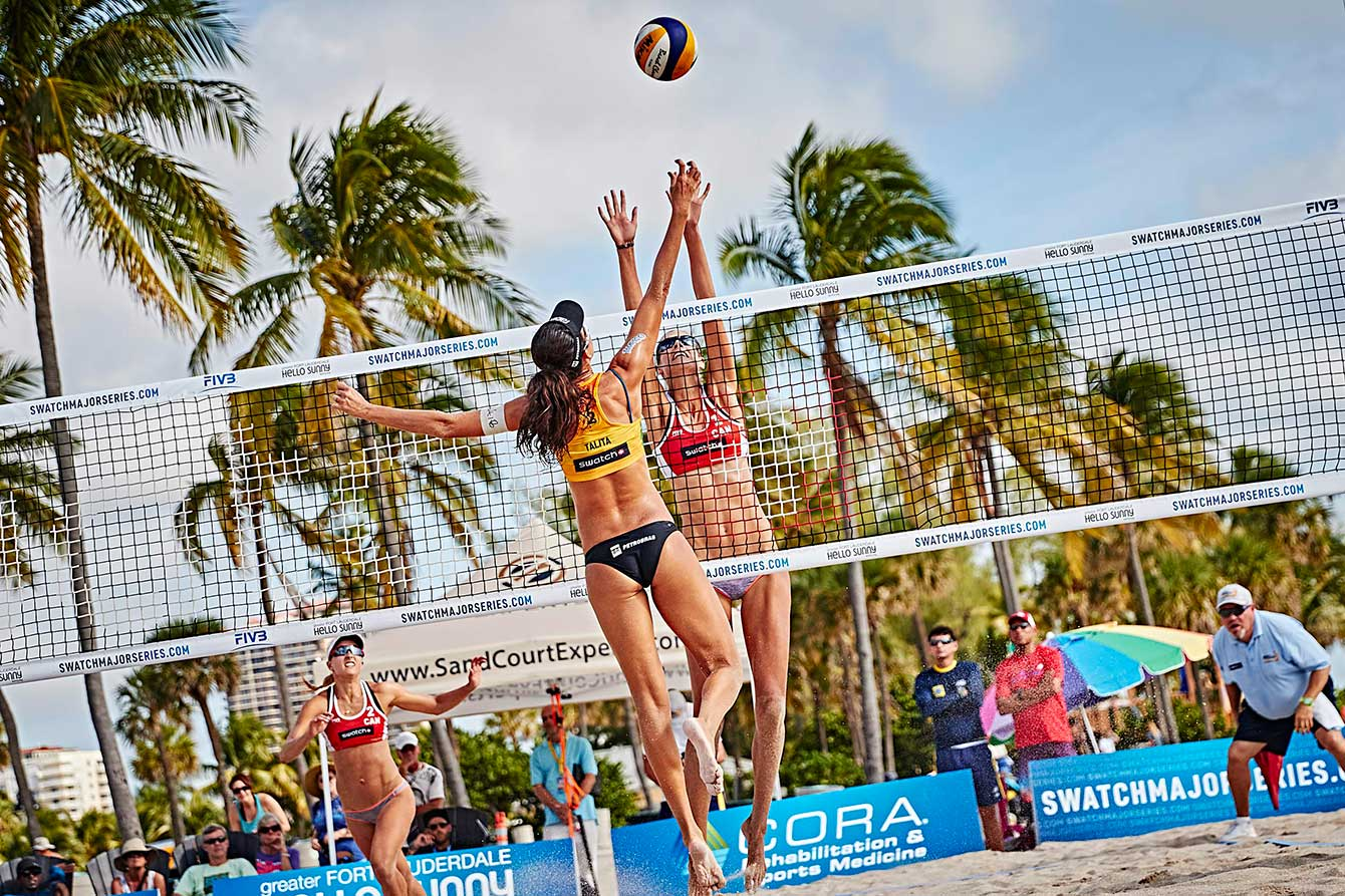 Sarah Pavan goes up to block Talita of Brazil at the 2015 World Tour Finals in Ft. Lauderdale.