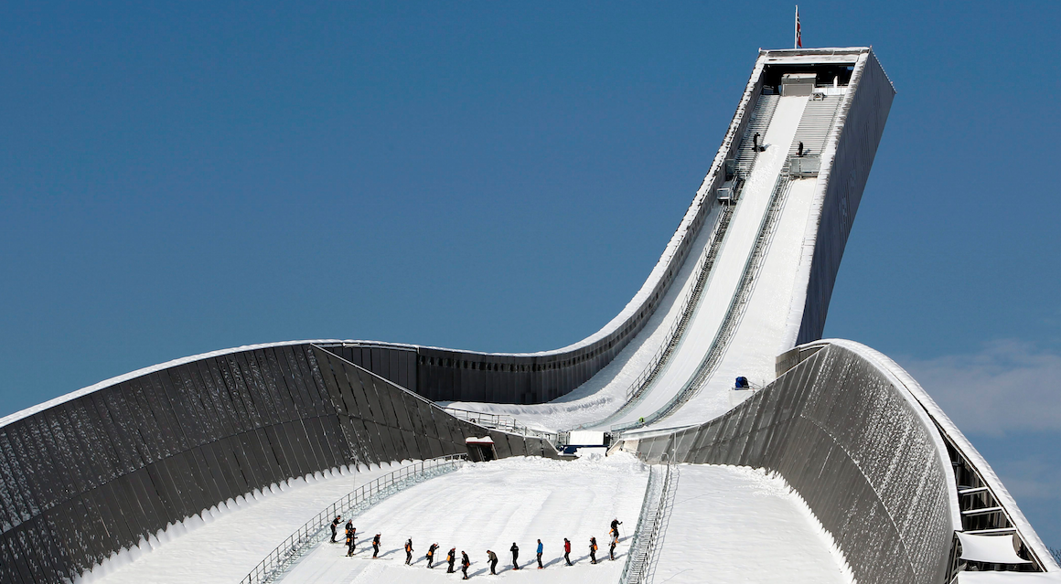 Workers prepare the Holmenkollen jumping hill during the Nordic World Ski Championships in Oslo, Norway, Sunday, Feb. 27, 2011. (AP Photo/Matthias Schrader)
