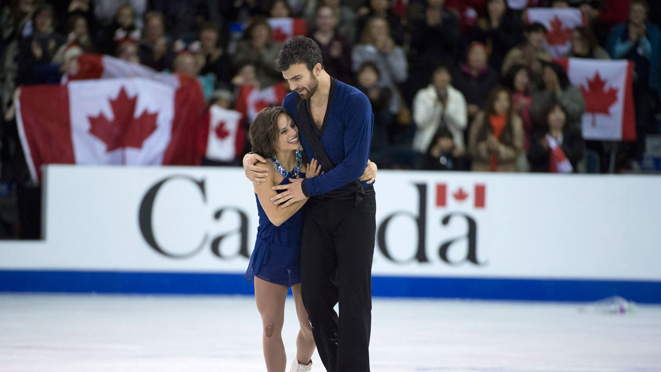 Meagan Duhamel and Eric Radford at the conclusion of their pairs free program at Skate Canada International on October 31, 2015.