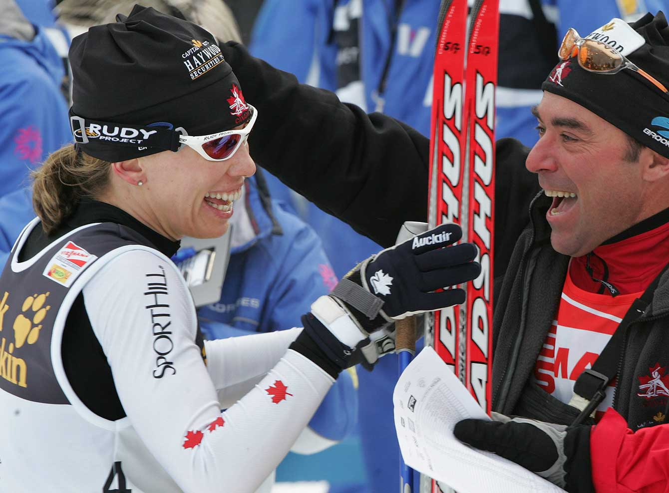 Canada's Beckie Scott celebrates her victory in the 15 km women's pursuit race at the cross country skiing World Cup races in Oberstdorf, southern Germany, Saturday, Jan. 21, 2006 with head wax technician Yves Bilodeau. (AP Photo/Diether Endlicher)