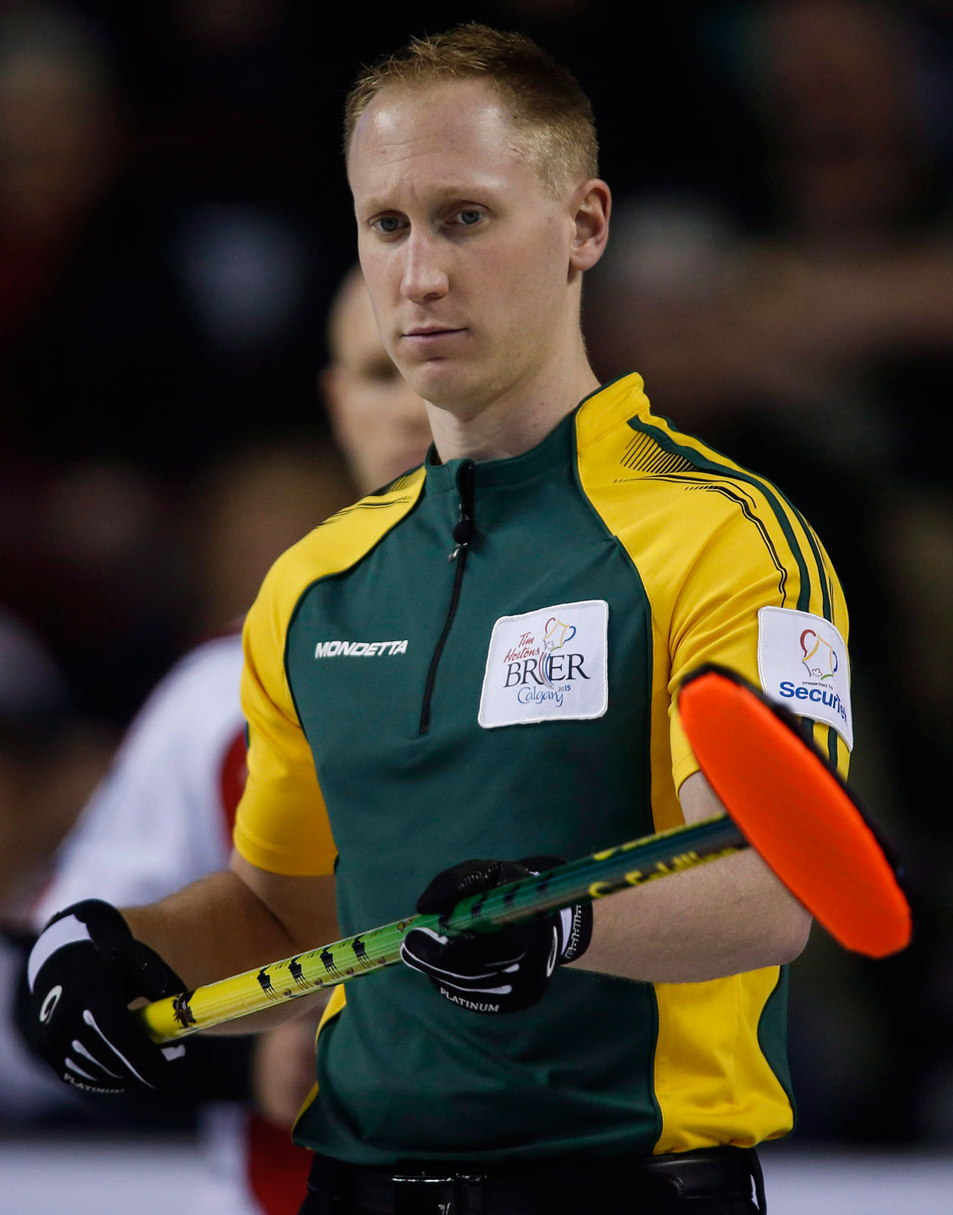Brad Jacobs, toting a regular broom at the 2015 Brier.
