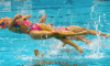 How synchronized swimming is reaching new heights