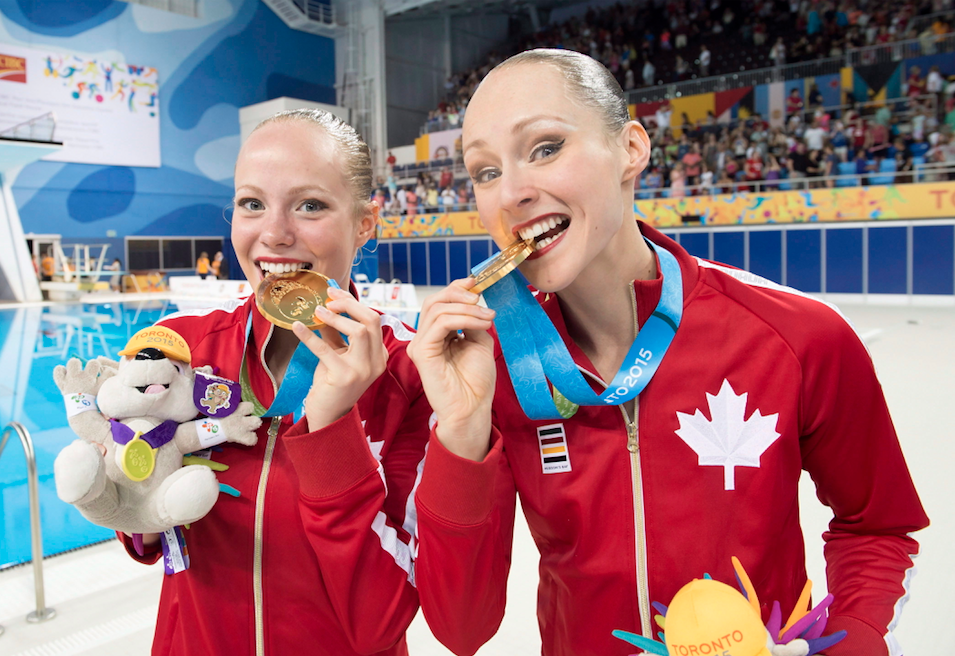 Canadians Jacqueline Simoneau and Karine Thomas (right) show off their Gold medals after winning the Synchronized Swimming Duet at the 2015 Pan Am Games in Toronto on Saturday, July 11, 2015.
