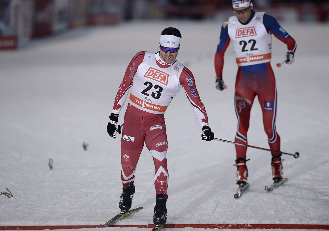Alex Harvey edges Dario Cologna of Switzerland in Kuusamo, Finland to win FIS World Cup skate-ski silver on November 28, 2015.