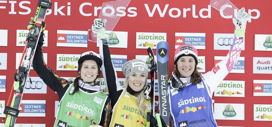 Kelsey Serwa (left) celebrates her second place finish at a FIS World Cup ski cross event in Innichen, Italy on December 20, 2015 (Photo via Alpine Canada).