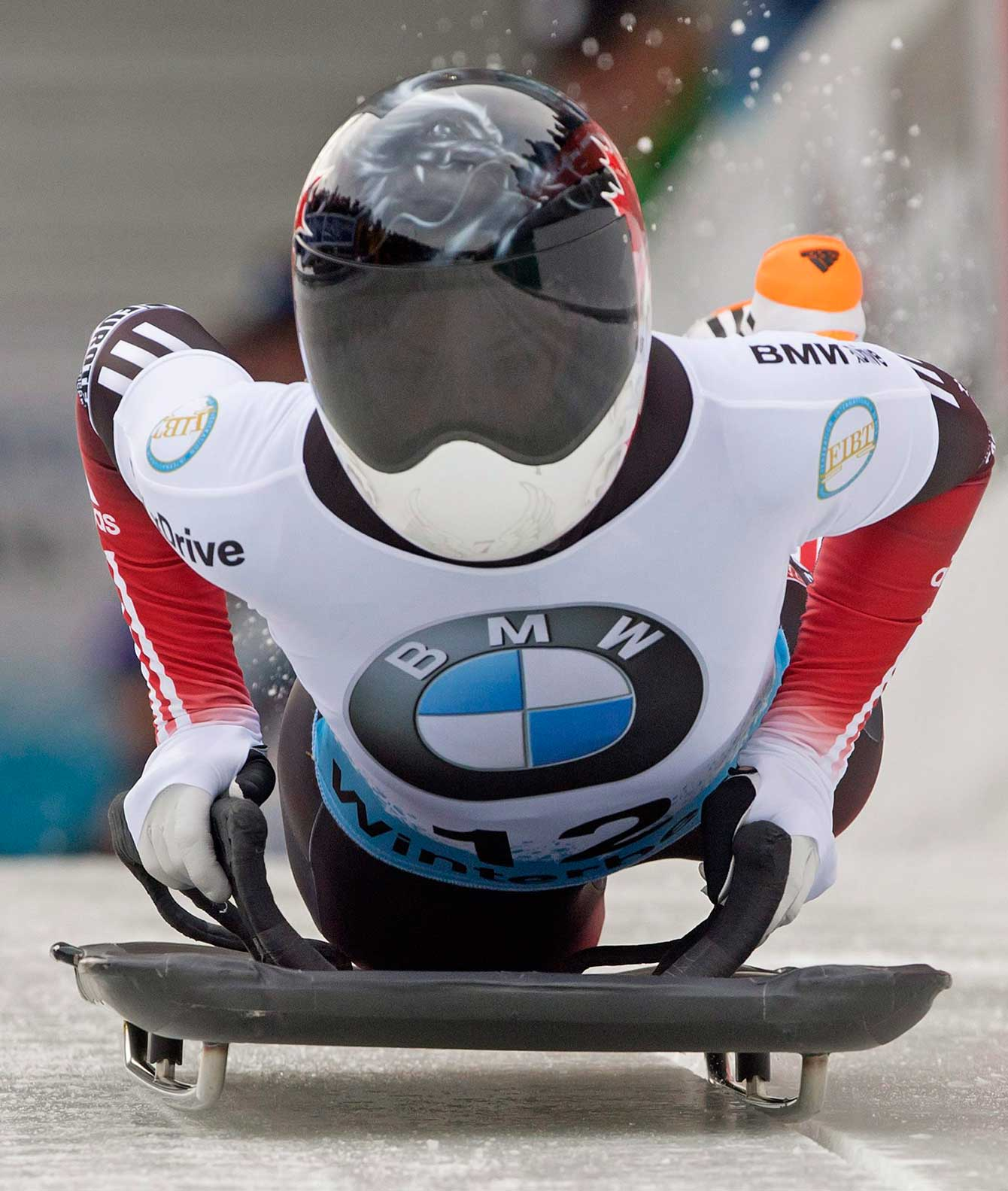 Jane Channell of Canada starts during her third run in the women's skeleton race at the Bob and Skeleton World Championships in Winterberg, Germany, Saturday, March 7, 2015. (AP Photo/Jens Meyer)
