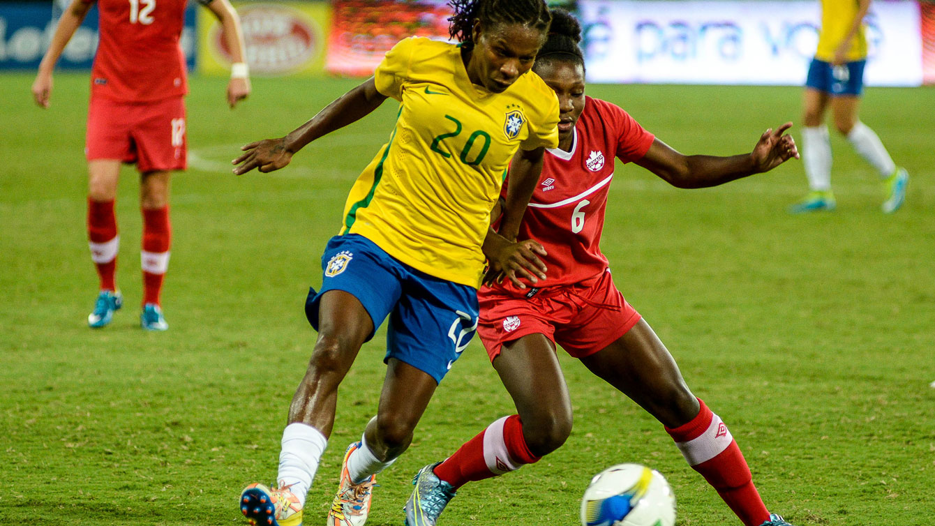 Deanne Rose (right in red), a 16-year old from Ontario, made her debut for Canada at the International Tournament of Natal. Rose appeared in the Natal invitational final against Brazil at the 64th minute (Photo: Vladimir Alexandre/Allsports).