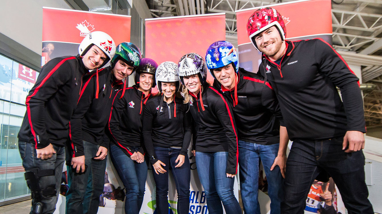 Canadian Luge Association athletes show off their artist-designed helmets on December 14, 2015, ahead of the Luge World Cup in Calgary (Photo: Dave Holland/Luge Canada).