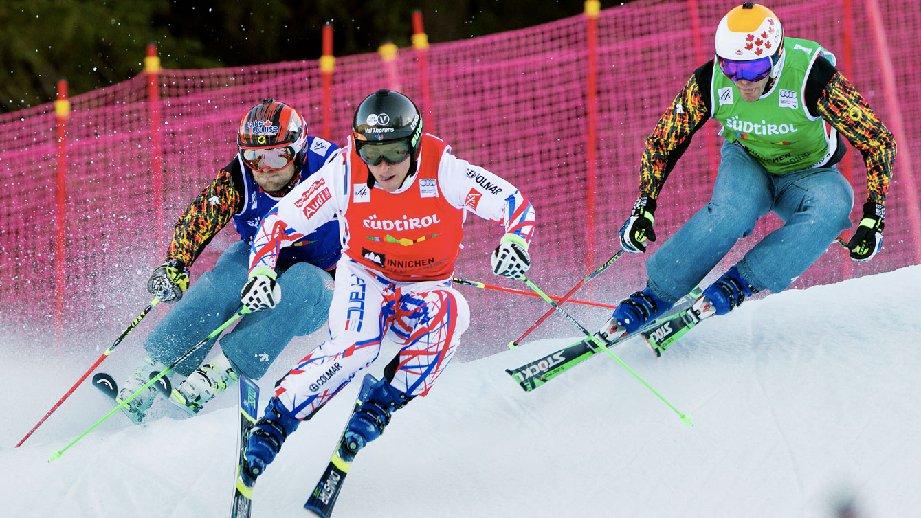 Canada's Brady Leman (left) and Chris Del Bosco (right) chase France's Jean Frederic Chapuis of France during the quarterfinals of the World Cup in Innichen, Italy on December 19, 2015 (Photo: GEPA Pictures for FIS).
