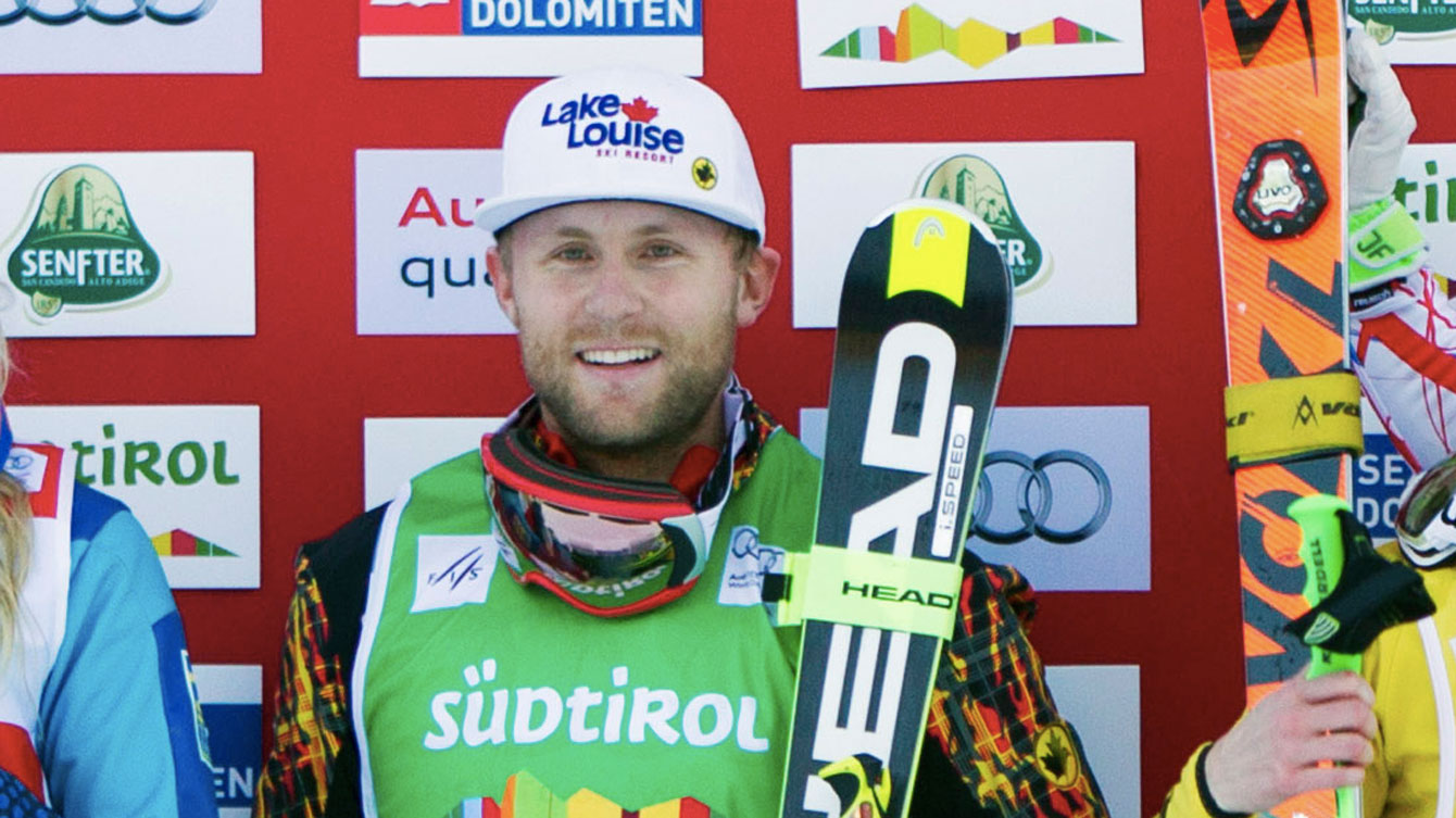 Brady Leman on the World Cup podium at Innichen, Italy on December 19, 2015 (Photo: GEPA Pictures for FIS).