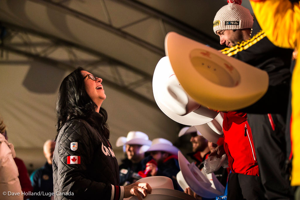 Canadian Olympic Committee president Tricia Smith hands out prizes at the podium following the doubles and women's competitions at the Luge World Cup in Calgary on December 18, 2015.