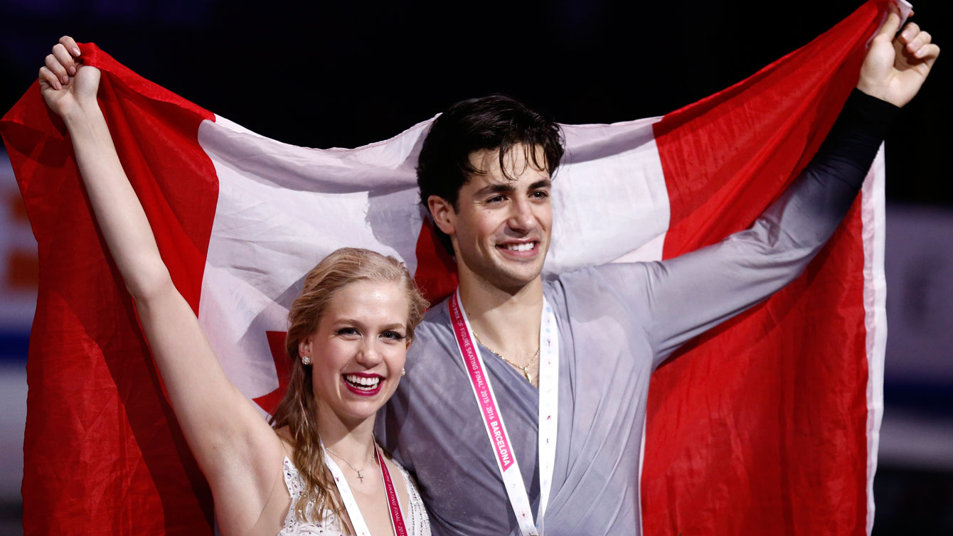 Kaitlyn Weaver and Andrew Poje on the podium after winning the ice dance title at the Grand Prix Final in Barcelona on December 12, 2015.