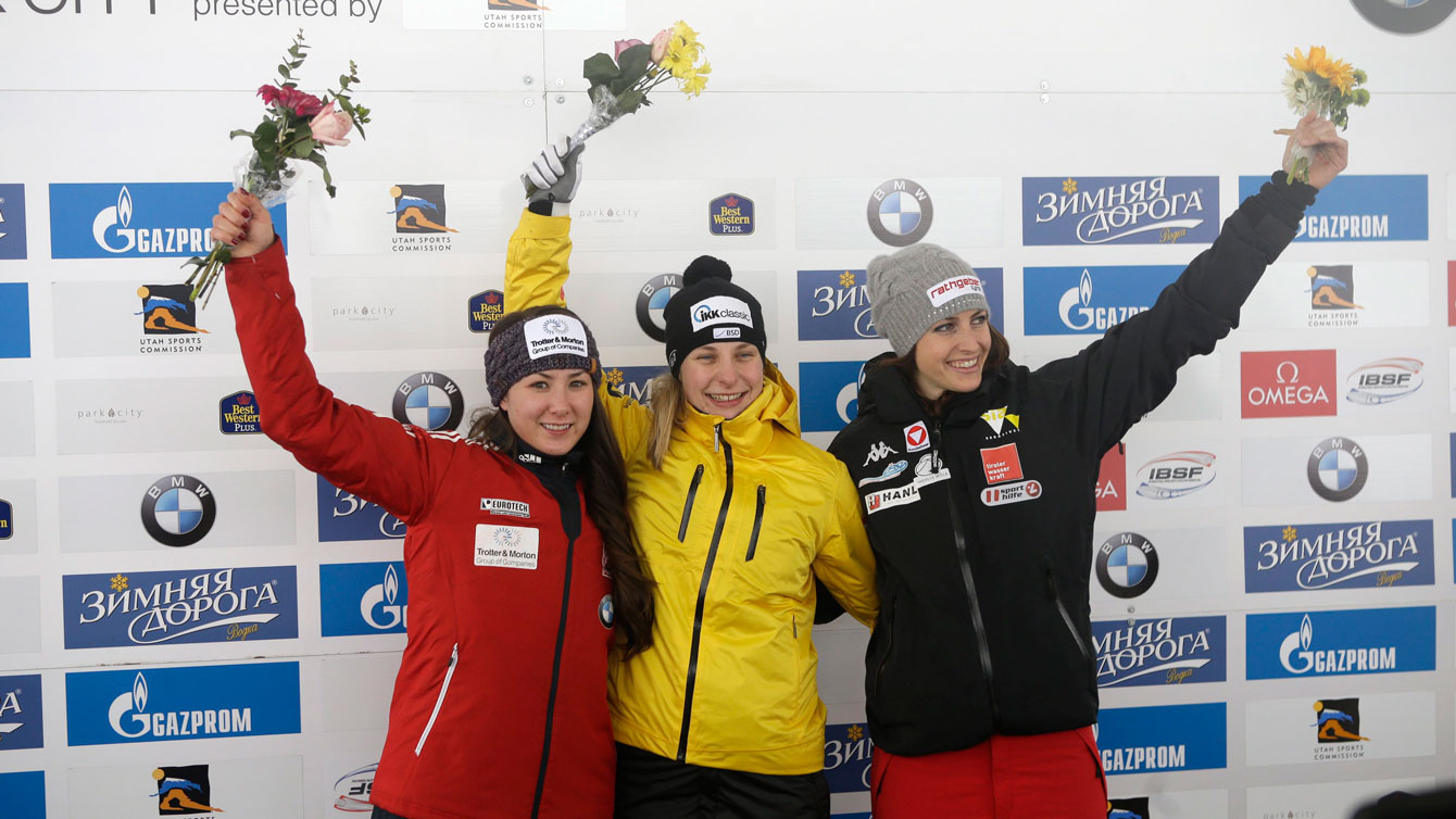Jane Channell (left) celebrates her second place World Cup finish in women's skeleton during the flower ceremony at Park City, Utah on January 16, 2016.