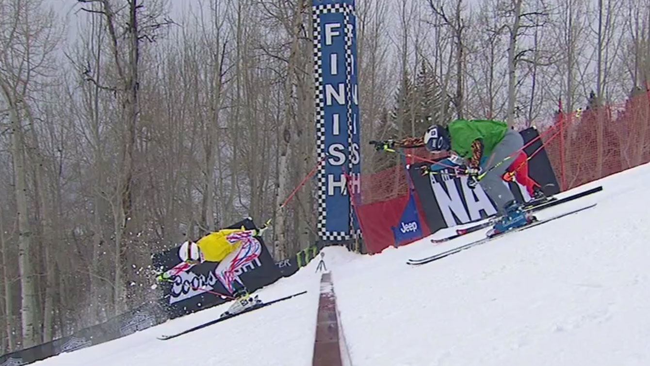 Chris Del Bosco (green bib) extends his arm to beat Alex Fiva of Switzerland for third place at X Games skier x (ski cross) on Saturday, January 30, 2016.