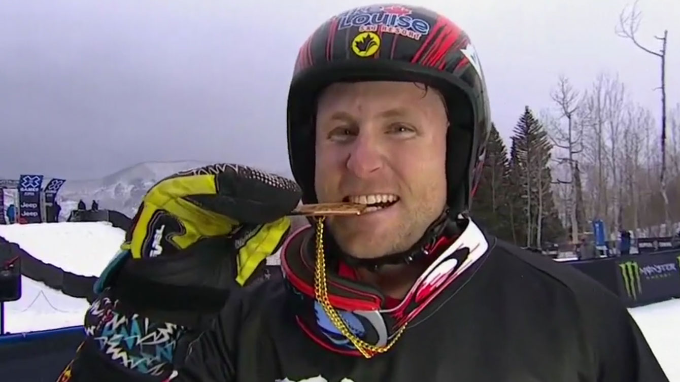 Brady Leman bites the X Games medal after winning skier x (ski cross) gold on January 30, 2016.