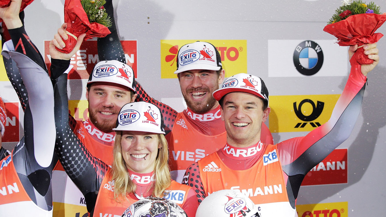 Canadians Justin Snith, Alex Gough, Tristan Walker and Mitchel Malyk celebrate team relay bronze at FIL World Championships on January 31, 2016.