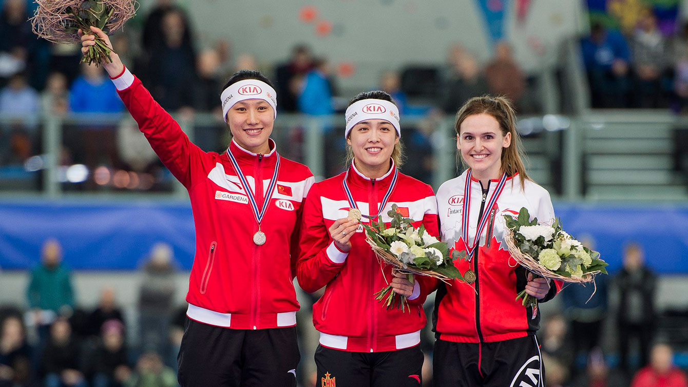 Heather McLean (right) on the World Cup podium following the women's 500m race in Stavanger, Norway on January 30, 2016.
