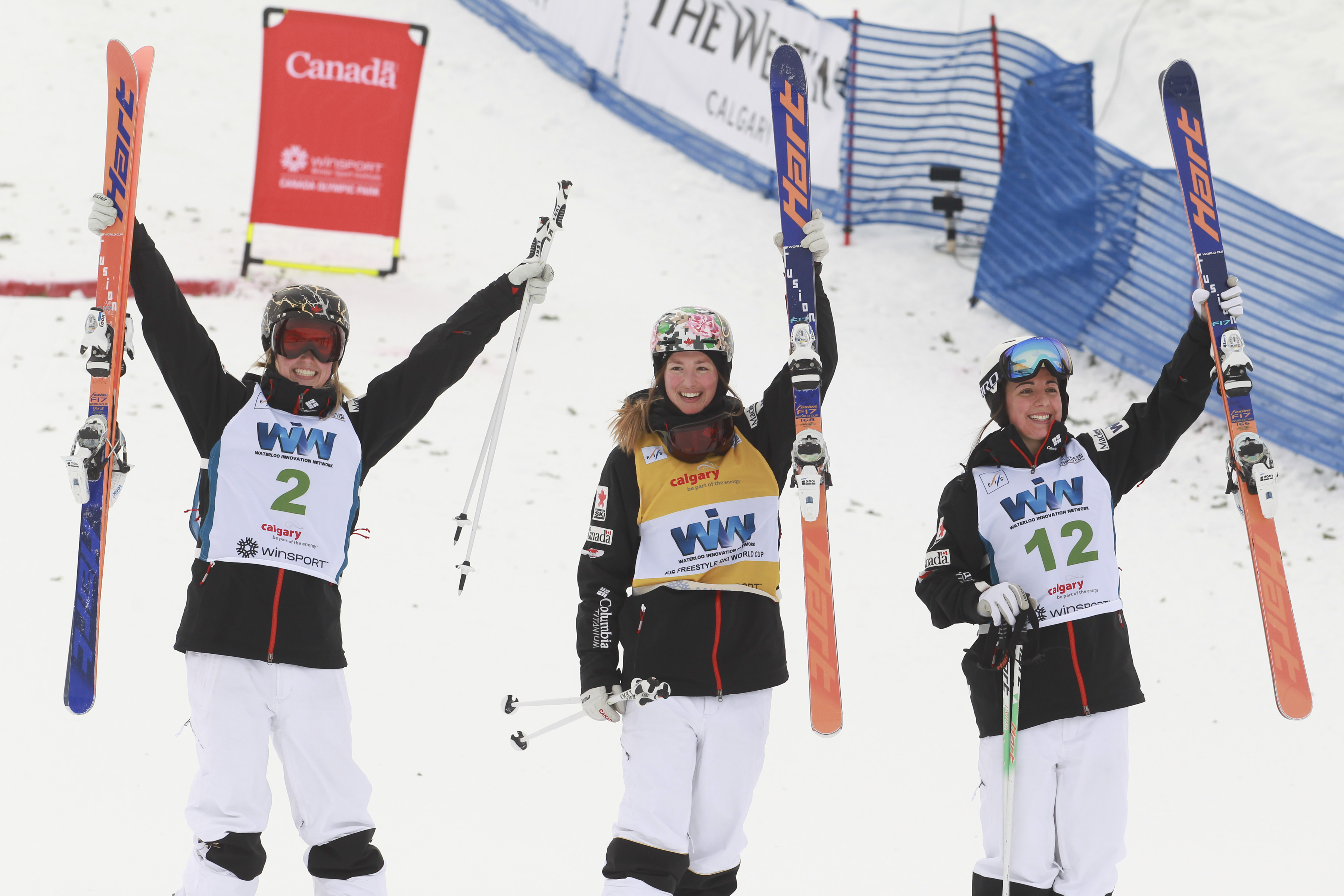 The top three in women's moguls at the FIS freestyle ski World Cup in Calgary, January 30, 2016. From left, Justine Dufour-Lapointe (second), Chloe Dufour-Lapointe (first) and Andi Naude. (Photo: Mike Ridewood/CFSA)