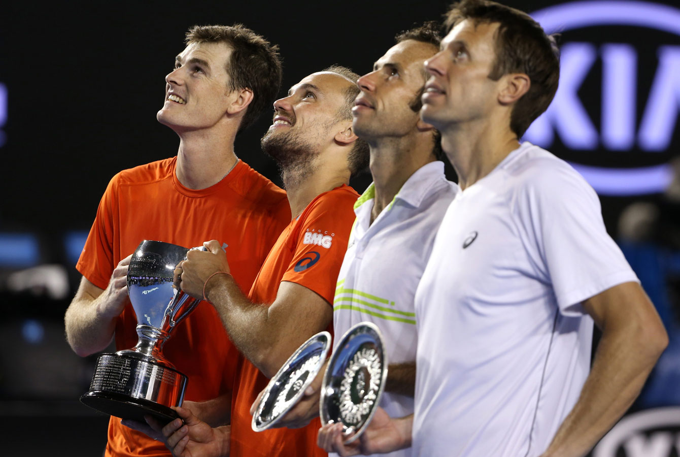 Daniel Nestor (right) holds the runner-up plate at the Australian Open after the men's doubles final on January 30, 2016.