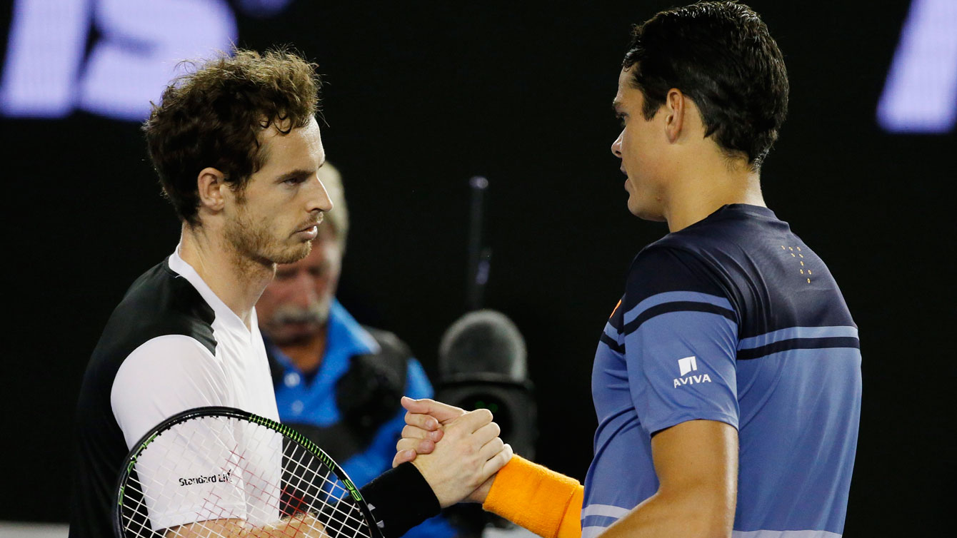 Milos Raonic (right) shakes hands with Andy Murray at the end of the Australian Open semifinal tie on January 29, 2016.