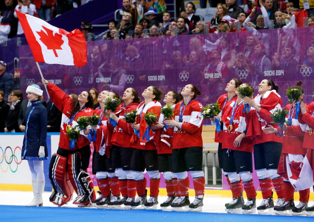 Team Canada sings the Canadian national anthem after receiving their gold medals after beating the USA 3-2 in overtime of the women's gold medal ice hockey game at the 2014 Winter Olympics, Friday, Feb. 21, 2014, in Sochi, Russia. (AP Photo/Mark Humphrey)