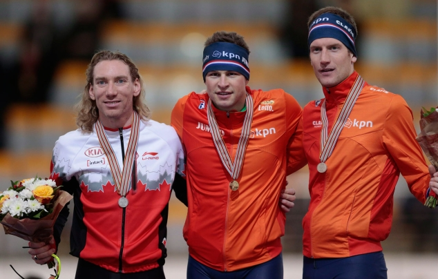Ted posing with his medal alongside other medallists